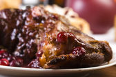 Delicious Scrambled Grilled meat with cranberry sauce — Stock Photo