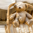 Teddy Bear toy and slide with snow covering — Stock Photo #1746257