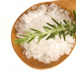 Sea salt with rosemary on a wooden spoon — Stock Photo