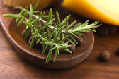 Allspice with fresh rosemary, cheese and onion — Stock Photo