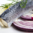 Stock Photo: Fillet herring with onion and lemon