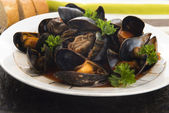 Clams in tomato sauce — Stock Photo