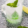 Glass made of ice with vodka, lemon and mint — Stock Photo #48953397