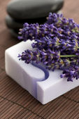 Bar of natural soap and lavender flowers — Stock Photo