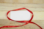 Red ribbon card note — Stock Photo