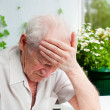Royalty-Free Stock Photo: Senior Man With Headache