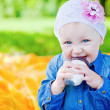 Little Girl Eating Candy — Stock Photo
