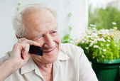 Old Man Enjoying a Telephone Conversation — Stock Photo
