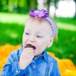 Girl Eating Candy — Stock Photo #21341381