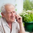 Royalty-Free Stock Photo: Sad Senior Man With Phone