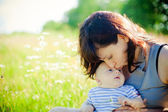 Mother Kissing Her Little Son — Stock Photo