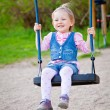Stock Photo: Smiling Girl Swinging