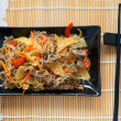 Rice noodles with meat and vegetables — Stock Photo