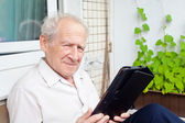 Old Man With a Touchpad PC — Stock Photo