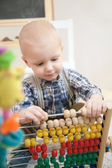 Little boy with abacus — Stock Photo