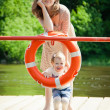 Woman and her daughter posing with buoy — Stock Photo #50338079