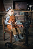 Little boy with hammer imitating the cobbler — Stock Photo