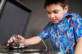 Boy with record player — Stock Photo