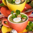 Stock Photo: Two cup with broccoli soup and pipes egg