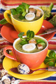 Two cup with broccoli soup and pipes egg — Stock Photo