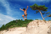 Boy Jumping Off Cliff — Stock Photo