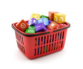 Shopping basket with media boxes — Stock Photo