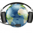Stock Photo: Earth planet with earphones and microphone