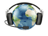 Earth planet with earphones and microphone — Stock Photo