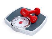 Weight scale with red dumbbells — Stock Photo