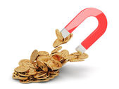 Magnet with golden coins — Stock Photo