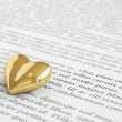 Golden heart on invitation letter — Stock Photo #39164131