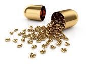 Golden pills — Stock Photo