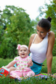 Beautiful young mother daughter relaxing — Stock Photo