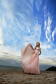 Woman in a pink dress — Stock Photo