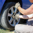 Senior man changing a wheel of his car — Stock Photo #11949221