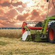 Combine harvester on a wheat field — Stock Photo #39761855