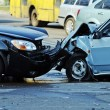 Auto accident involving two cars on a city street — Stock Photo #40248311