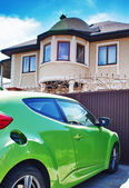 Luxury sport car in front of a house — Stock Photo