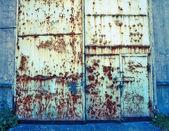 Old metal door with rust — Stock Photo