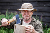 Senior man with axe — Stock Photo
