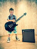 Little boy with rock guitar — Stockfoto