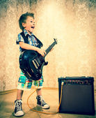 Little boy with rock guitar — Stock Photo