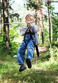 Child boy in adventure park — Stock Photo