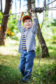 Child boy in adventure park — Stock Photo