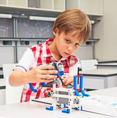 School Boy playing with construction set — Stock Photo