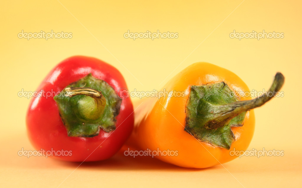 Hot red chili peppers on yellow background — Lizenzfreies Foto #13178446