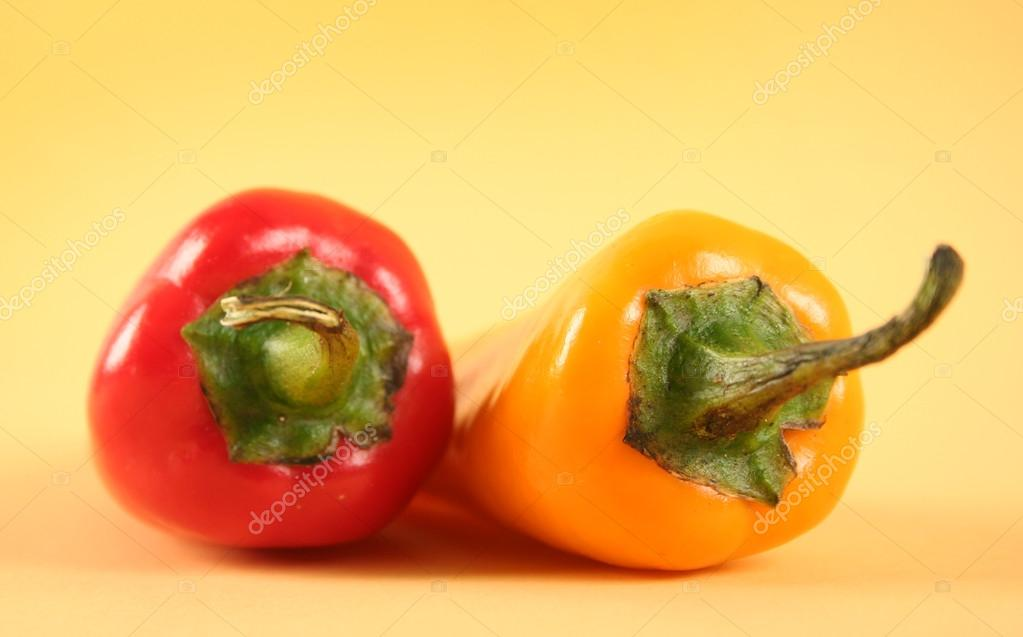 Hot red chili peppers on yellow background  Stockfoto #13178446