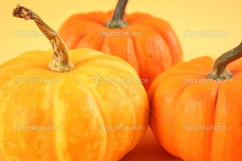 Orange pumpkin on yellow background — Stock Photo #13178471