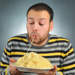 Man and pasta — Stock Photo