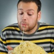 Stock Photo: Man and pasta